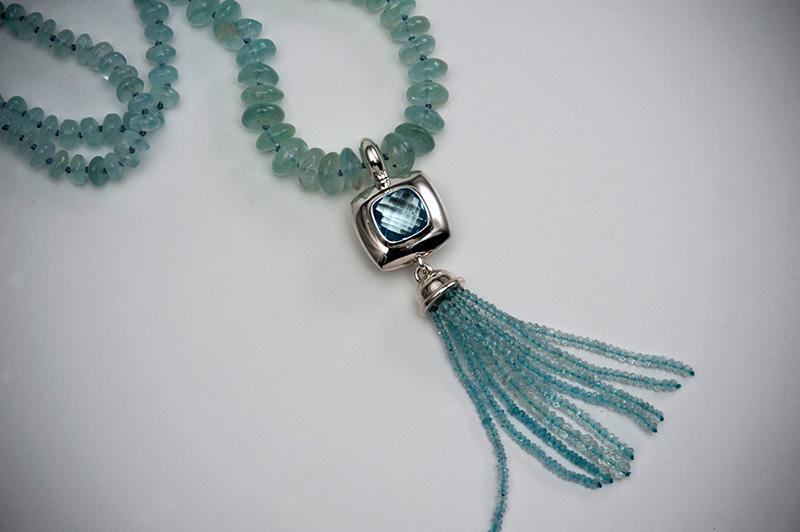 Topaz pendant with aquamarine tassel