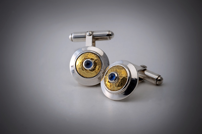 Cufflinks with hammered gold domes and sapphires