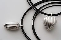 Silver fluted pendants with black neoprene chords