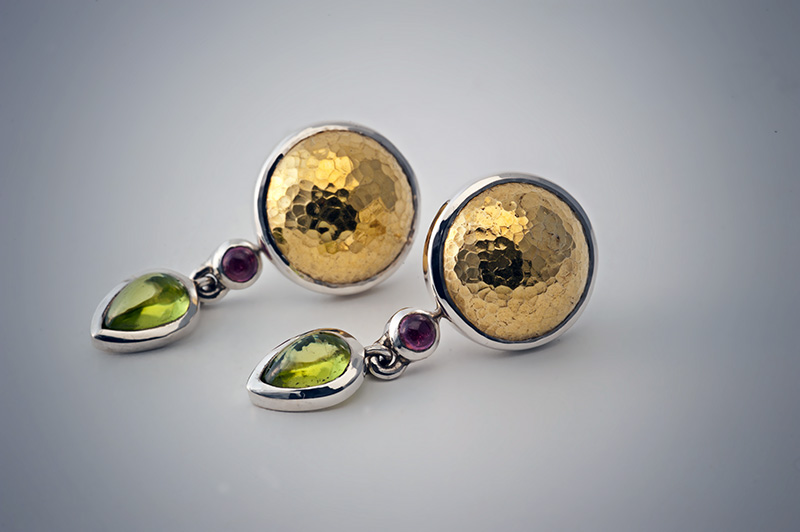 Stud earrings in silver with hammered 24carat gold domes with removable drop set with gemstones